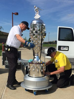 Lee Cole (right) and Ken Lemmon care for the Borg-Warner Trophy.