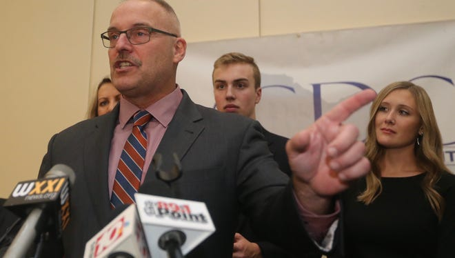 Monroe County Sheriff-elect Todd Baxter addresses the crowd at the Monroe County Democratic Party headquarters.
