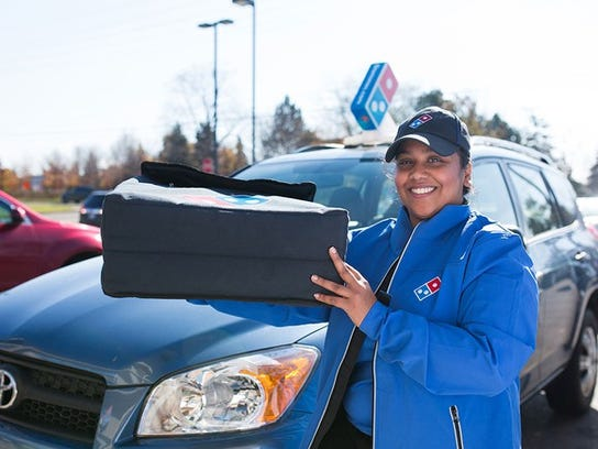 Female delivery driver holding a thermal bag