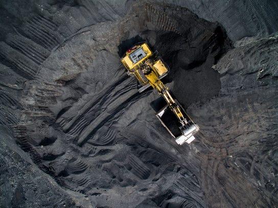 Overhead shot of excavator in coal mine.
