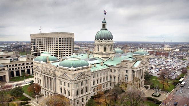 The Indiana Statehouse is seen looking off the roof of the Capitol One Building over the corner of Capitol and Washington avenues.