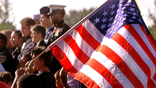 Lafayette Parish students and local military personnel participate in an event remembering the Sept. 11, 2001 terrorist attacks.