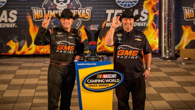 Driver Johnny Sauter and crew chief Joe Shear Jr. pose in victory lane at Texas Motor Speedway after scoring their second consecutive NASCAR Camping World Truck Series win.