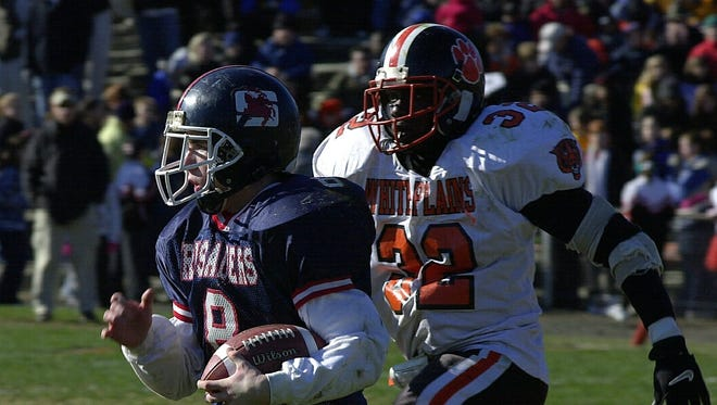 During the 2000 Turkey Bowl, Stepinac's Tyler Nugent runs for short yardage in the second quarter with White Plains' Paul Overton trailing after him.