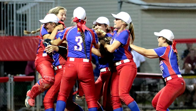 Lakewood players swarm pitcher Courtney Vierstra, after the Lancers beat Akron Hoban 2-1 Saturday night for the Division II state championship at Akron's Firestone Stadium.