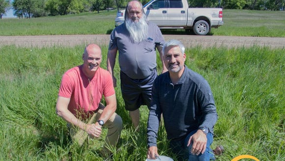Russel and Dave Olson pose with Taylor Hicks while