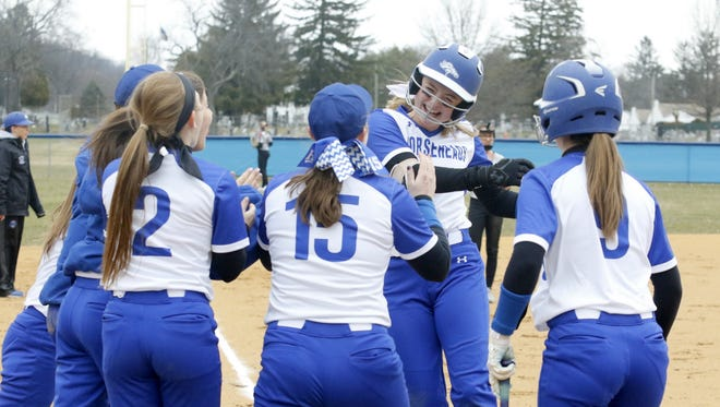 Kendal Cook of Horseheads is greeted by teammates after hitting a home run in the bottom of the first inning of a 7-4 victory over Elmira on April 11 in Horseheads.