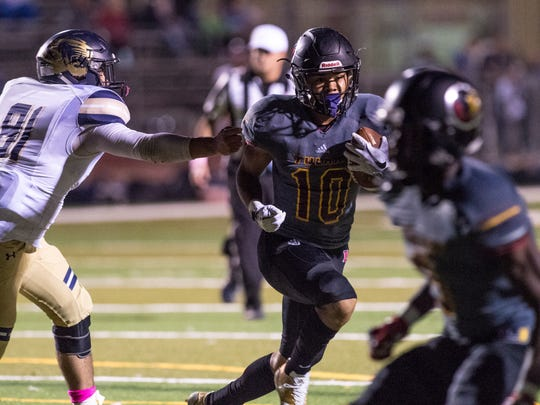 Tulare Union's Kazmeir Allen picks up seven yards against