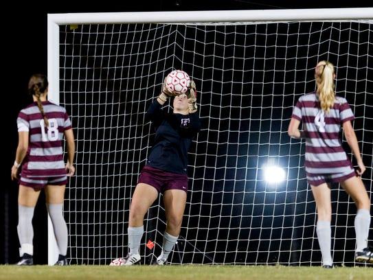 Bearden goalie Abby Mink catches a shot during a sectionals