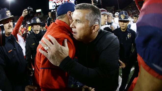 UA head coach Rich Rodriguez greets ASU head coach Todd Graham after the Wildcats defeated the Sun Devils during the 90th Territorial Cup game on Nov. 25, 2016 at Arizona Stadium in Tucson, Ariz.