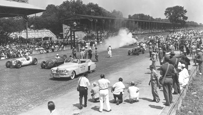 A view of the track for its first Indianapolis 500 under new owner Tony Hulman. Henry Ford II drove the Lincoln convertible pace car at the start of the 1946 race. Tony Hulman rode in the pace car and turned to watch the action behind him.