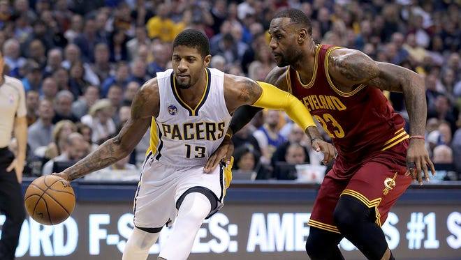 Indiana Pacers forward Paul George (13) drives on Cleveland Cavaliers forward LeBron James (23) in the first half of their game Monday, Feb 1, 2016, evening at Bankers Life Fieldhouse.