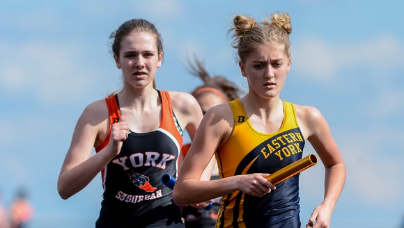 Eastern York's Maddie McLain, front,finished third in the 800 and was runner-up in the mile to Northern York standout Marlee Starliper at the recent Arctic Blast Invitational. DISPATCH FILE PHOTO
