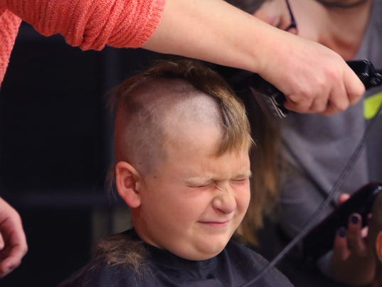 10 Reagan students shave heads for Alopecia Awareness