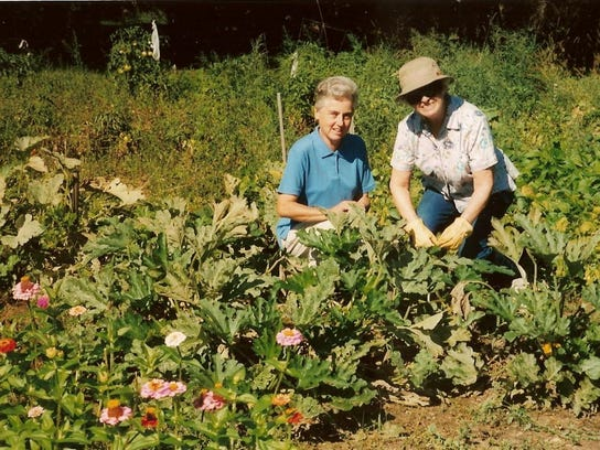 Members of the Sisters of Mercy tending to the garden.