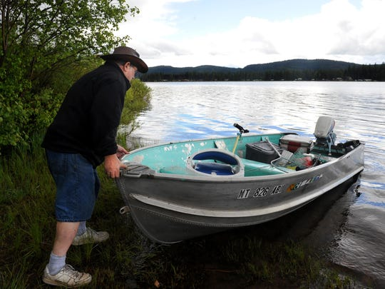 A fisherman heads out for an afternoon of fishing from the Big Larch campground boat ramp at Seeley Lake on, June 13, 2012.