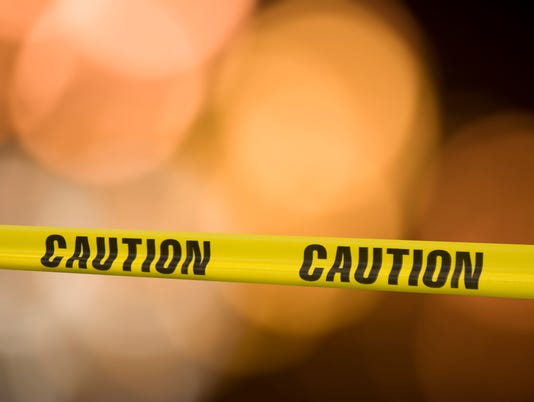 Yellow caution tape with blurry background