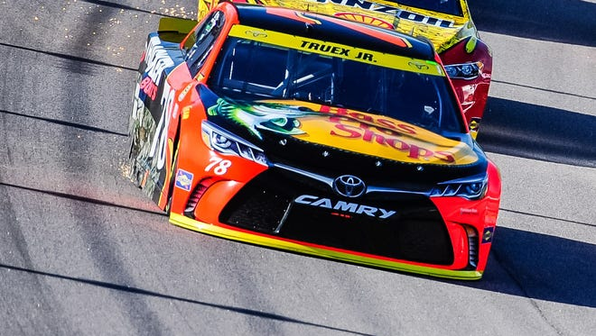 Martin Truex Jr., front, finished 11th Sunday at Kansas Speedway.
