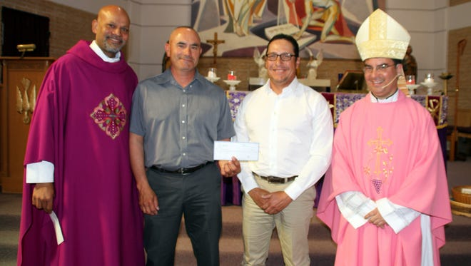Bishop Oscar Cantu, of the Catholic Diocese of Las Cruces, gave a special mass on Sunday at Holy Family Catholic Church. At the conclusion of the mass, Bishop Cantu and Fr. Ron Machado presented the Cancer Support Group of Deming and Luna County Inc. with check for $1,794 for its continued work in helping local cancer patients. The Cancer Support Group transports patients to and from out-of-town treatment centers, provides wigs, scarves and prosthetics, has an extensive resource library and also assists families with filing paper work. On hand for the presentation were, from left, Fr. Ron, and Cancer Support board members, Deming Mayor Benny Jasso and Rey Trejo; and Bishop Cantu. The money raised for the donation came from the Holy Family congregation.