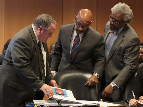L-R Assistant Wayne County Prosecutor showing exhibit