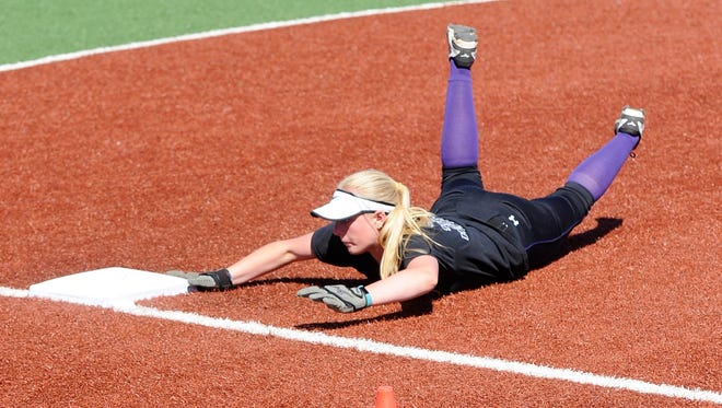 Wylie's Shelby Russell slides into third base during a base running drill at practice on Monday, March 12, 2018.