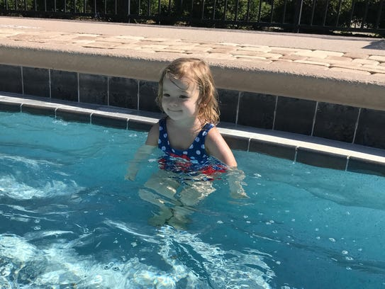 Isabella loved swimming during her third birthday party.