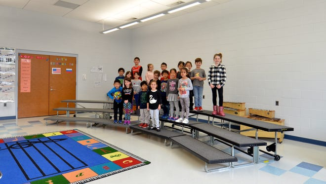 Alpine School District recently underwent a renovation project which included a new music room, a new auditorium and stage and new classrooms. The students in the new music room.