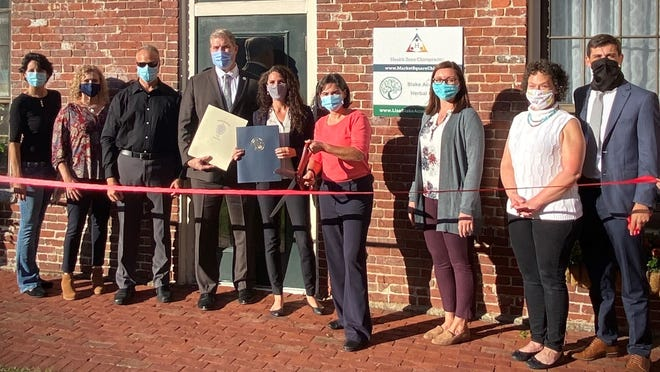 Health Zone recently opened at its new location in Amesbury. Shown here, left to right, are L-R) Laura Soussan, member of the Amesbury Chamber Board of Directors and co-owner of CommSat IT Services; Christine Morency of Newburyport Bank and member of the Board; Matt Sherrill, owner of Gould Insurance and member of the Board; State Rep. Jim Kelcourse; State Sen. Diana DiZoglio; Dr. Kerry Goyette, owner of Health Zone Chiropractic; Amesbury Mayor Kassandra Gove; Michelle Baker of Dynamic Balance and member of the Board; and Phil DeCologero, Executive Director of the Amesbury Chamber of Commerce.