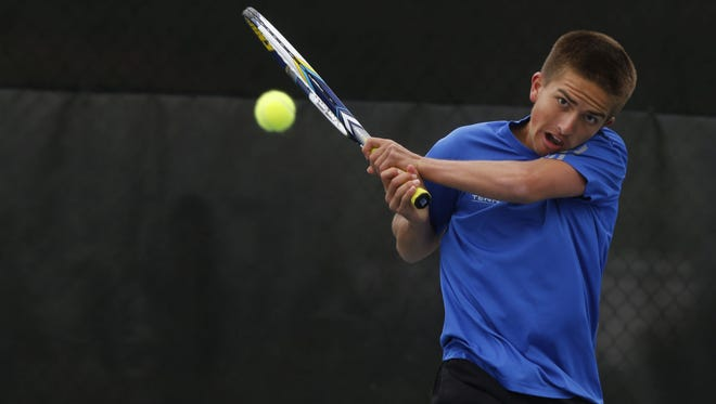 Kaleb Dobbs, of Sioux Falls Lincoln, returns the ball against Logan Barr, of Sioux Falls Roosevelt, during the flight one championship match Saturday afternoon during the high school state tennis tournament at Sioux Park.