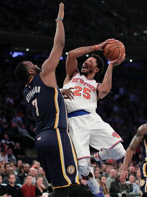 Knicks guard Derrick Rose (25) returns to action and looks to shoot against Indiana Pacers center Al Jefferson (7) on Tuesday, Dec. 20, 2016, in New York. The Knicks won 118-111.
