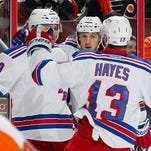 Kevin Hayes (13) celebrates a goal by J.T. Miller (10) last season. Now they are vying for the same lineup spot.