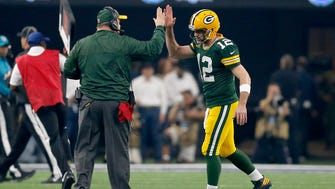 Packers quarterback Aaron Rodgers  and head coach Mike McCarthy celebrate a touchdown during first quarter of the divisional playoff game against the Dallas Cowboys.