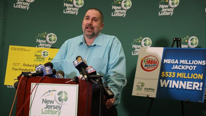 The winner of the $533 million lottery, Richard Wahl of Vernon speaks to gathered press at lottery headquarters.