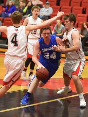 Cotter's Landon Martin tries to dribble between Norfork's Brett Sorters (4) and Jordan Rhymer on Tuesday night at Norfork.