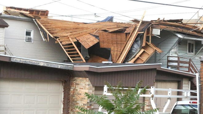 A storm damaged the roof at 201 Grant St. in Dennison Wednesday night.