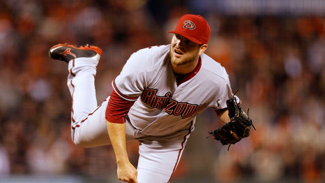 Apr 18, 2015: Arizona Diamondbacks pitcher Evan Marshall (50) follows through on a pitch against the San Francisco Giants in the seventh inning at AT&T Park. The Giants defeated the Diamondbacks 4-1.