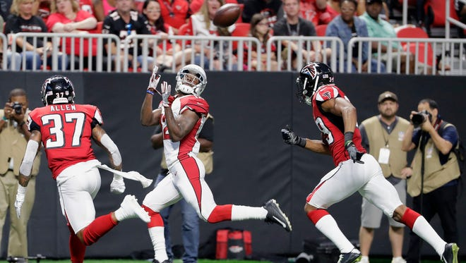 Arizona Cardinals wide receiver John Brown (12) makes a touchdown catch against Atlanta Falcons free safety Ricardo Allen (37) during the first half of an NFL football game, Saturday, Aug. 26, 2017, in Atlanta.