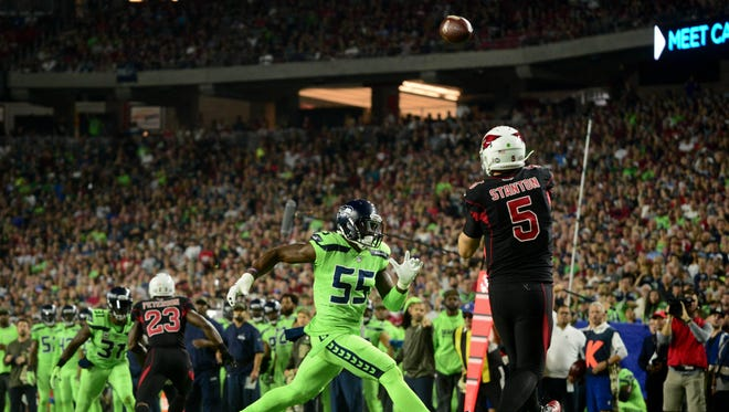 Nov 9, 2017; Glendale, AZ, USA; Arizona Cardinals quarterback Drew Stanton (5) throws while under pressure from Seattle Seahawks defensive end Frank Clark (55) during the first half at University of Phoenix Stadium. Mandatory Credit: Matt Kartozian-USA TODAY Sports