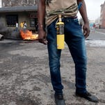 An immigrant armed with a petrol bomb on a street in Durban, South Africa, during clashes on April 14.