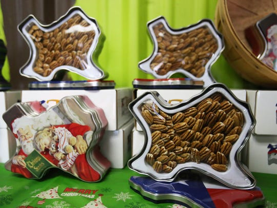 A Texas shaped tin filled with pecans are among the