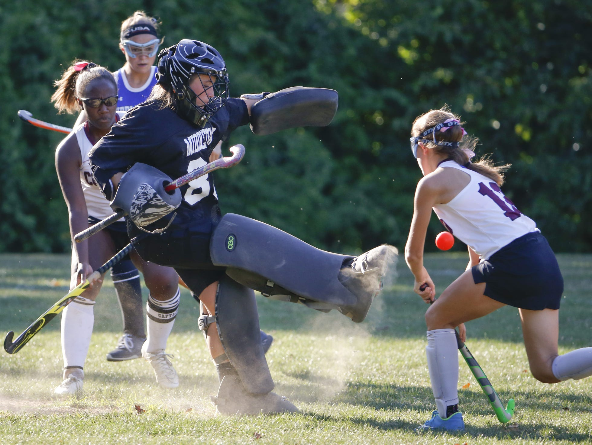 Middletown goalie Lauren Berry clears the ball away from Concord's Katie Raab (right) in the second half of Concord's 1-0 win Wednesday.