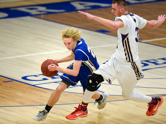 St. Cloud Cathedral's Andrew Weisser makes a quick cut around Melrose's Brady Birch during the second half Tuesday, Jan. 17 at Cathedral High School.
