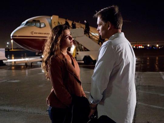 "Ziva (Cote de Pablo), left, and Tony (Michael Weatherly) share a tarmac goodbye, a la ""Casablanca,"" and a fan-cheered kiss in Ziva's ""NCIS"" farewell."