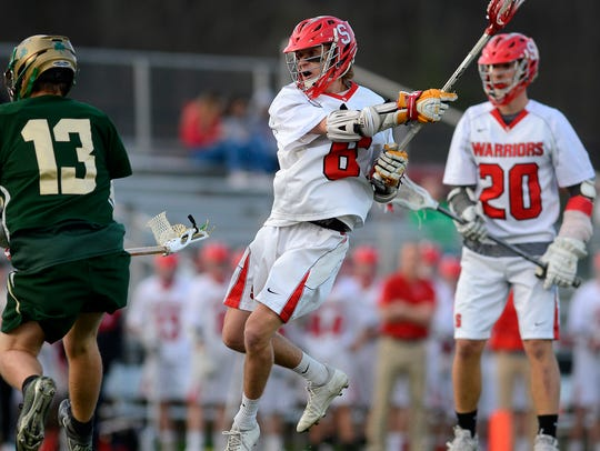 Susquehannock boys' lacrosse coach Russ LeBlanc is stepping down after helping lead the the Warriors, in action above in April against York Catholic, to the program's first PIAA Class 2-A tournament appearance. DISPATCH FILE PHOTO
