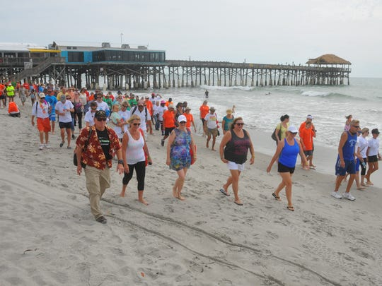 Hundreds showed up at the Cocoa Beach Pier in May 2017 for a paddle-out and the Footprints in the Sand Kidney Walk, part of the National Kidney Foundation's largest walk to fight kidney disease.
