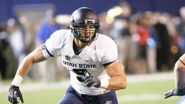 Utah State linebacker Kyler Fackrell (9) returns an interception for a 98-yard touchdown against Hawaii during the 2013 season.
