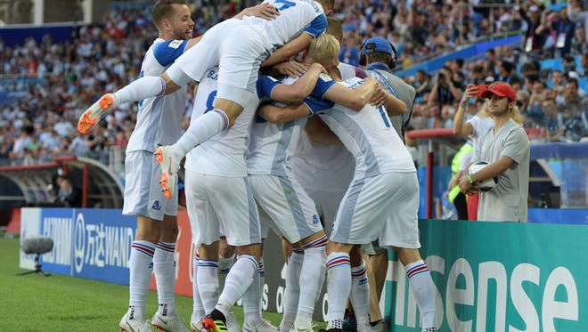 Iceland's forward Alfred Finnbogason is congratulated by teammates after scoring against Argentina.