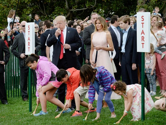 President Trump blows a whistle to start the egg roll.