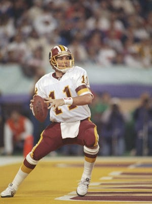 Quarterback Mark Rypien of the Washington Redskins looks to pass the ball against the Bills.