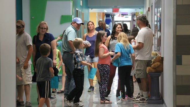 Parents and students visit Desert Willow Ocotillo Elementary Monday for the ribbon cutting ceremonies. School begins Thursday.